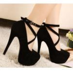 Black closed toe high heels with ankle strap